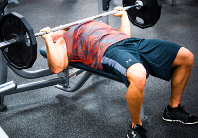 In order to increase your maximum bench press, should you bench close to your max or just do less weight for gradually more reps?